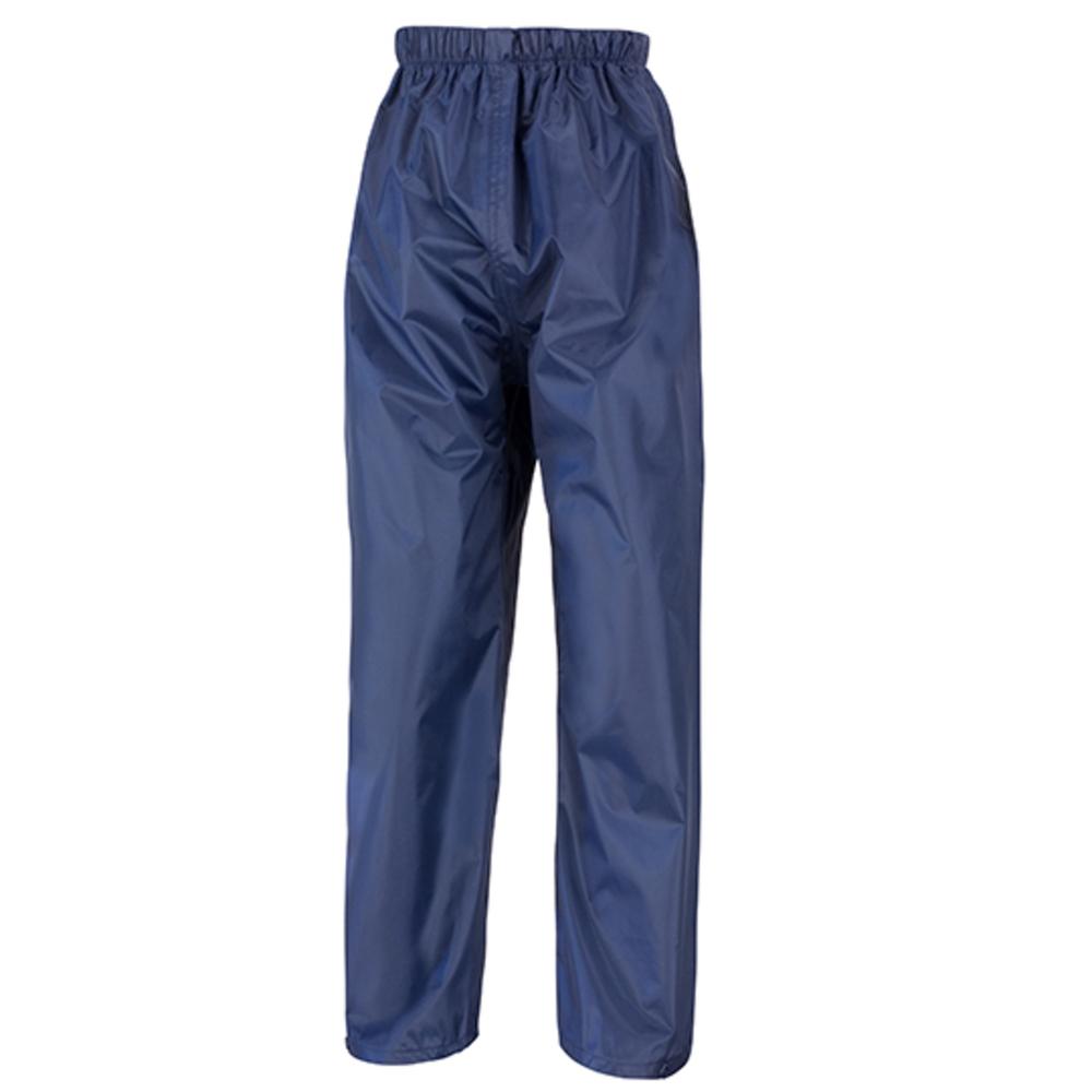 Junior impermeable sobre pantalones